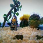 Close-up with a lego knight and cacti at the office